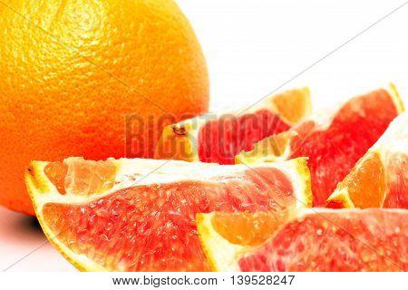 Orange with white background, ready to be eaten.