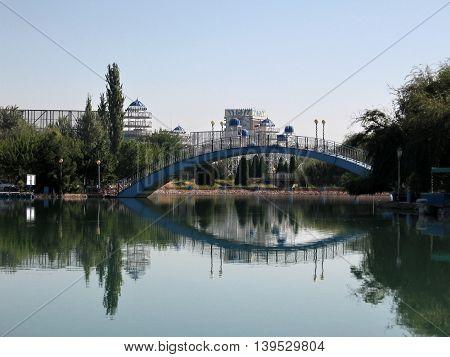 Pond and bridge in park Almazar in Tashkent the capital of Republic Uzbekistan