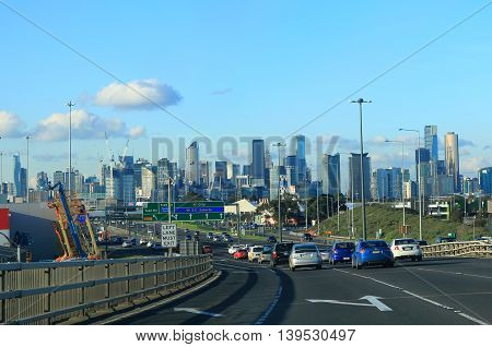MELBOURNE AUSTRALIA - JULY 9, 2016: Melbourne cityscape and freeway traffic