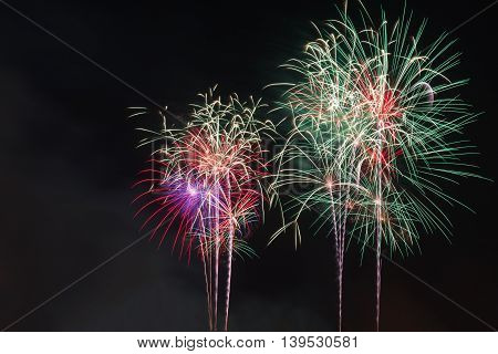 A variety of colorful fireworks  on black background