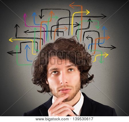Man with a questioning expression and design of arrows over his head