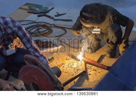 Industrial Worker at the factory welding .