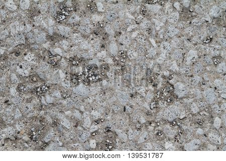 weathered concrete with pebbles showing grunge texture