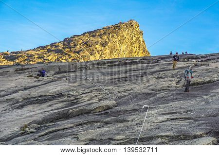 Ranau,Sabah,Borneo-March 13,2016:Group of climber move down from Low's Peak to Laban Rata at Mountain Kinabalu.There are two summit trails completed as of 18 May 2016,Ranau Trail & Kota Belud Trail.