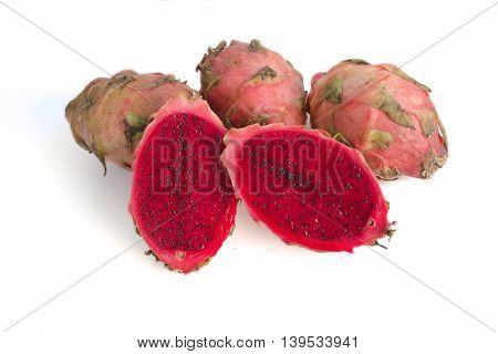 Bright red dragon fruit sliced and whole on white background