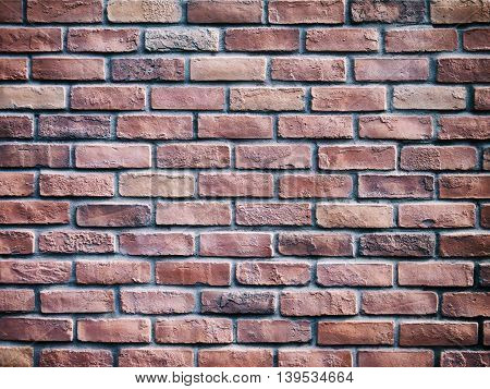 Background of old brown vintage brick wall