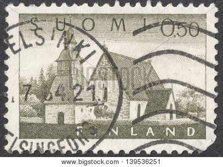 MOSCOW RUSSIA - JANUARY 2016: a post stamp printed in FINLAND shows an old church in Lammi the series