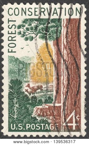 MOSCOW RUSSIA - JANUARY 2016: a post stamp printed in the USA shows aoods and animals Forest Conservation Issue circa 1958