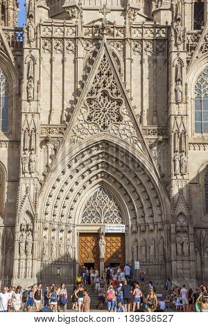 BARCELONA SPAIN - JULY 8 2016: Entrance to Cathedral of the Holy Cross and Saint Eulalia patron saint of Barcelona in Catalonia Spain.