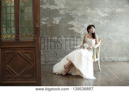 Beautiful Bride portrait wedding makeup and hairstyle, bride Asian model in studio