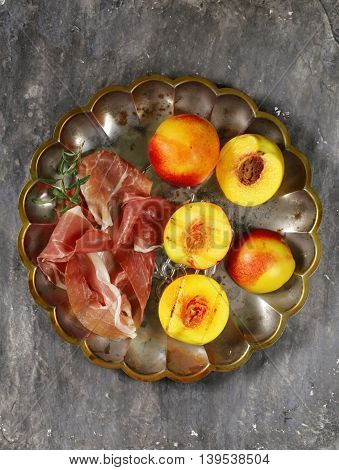 traditional Italian appetizer parma ham with sweet grilled peaches