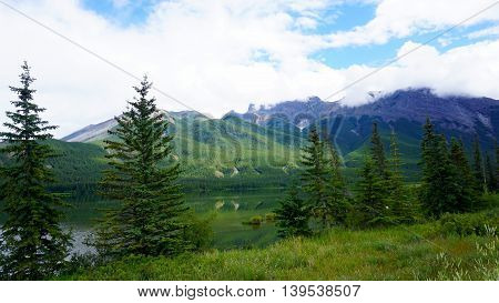 beautiful of National Park green lake blue sky for background of nature