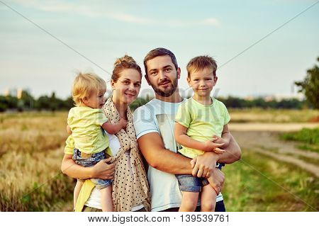 Happy young family together outside in nature.