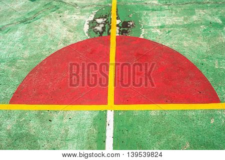 Green basketball court   and a harf red circle.