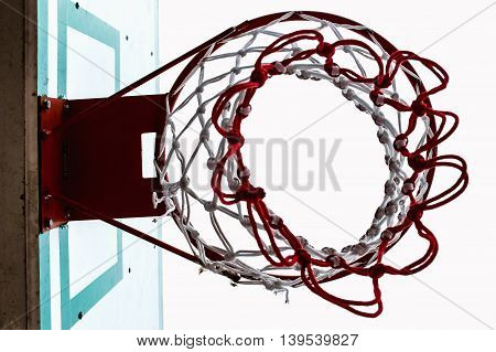 Basketball hoop on a red ring and White mesh.