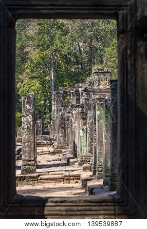 ruin buddha statue in ancient city with white sky , Cambodia