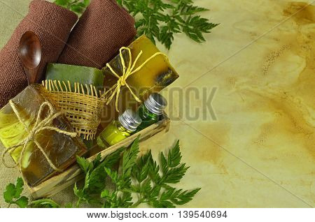 Spa set with handmade soap bars, perfume bottles, toiletries and copy space on shabby paper background