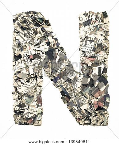 The letter N made from newspaper confetti