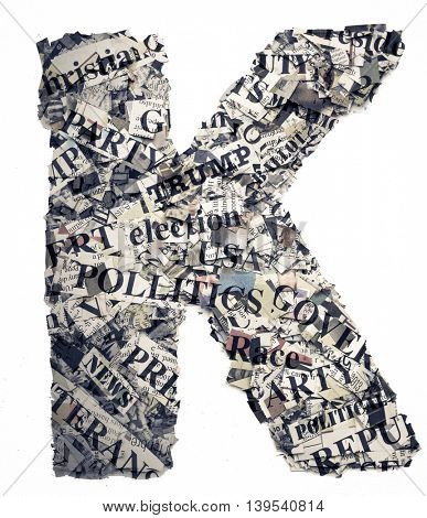 The letter K  made from newspaper confetti