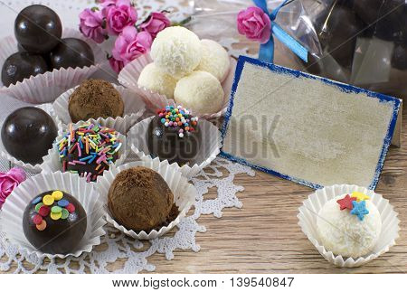Fancy chocolate candies with greeting card and decorations