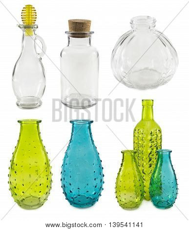 Assorted glass bottles and bowls isolated on white