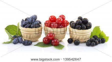 Three waffle tartlets with various berries isolated on white
