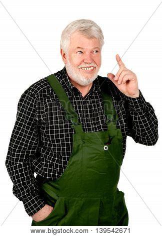 Smiling craftsman pointing a finger upwards isolated on white background