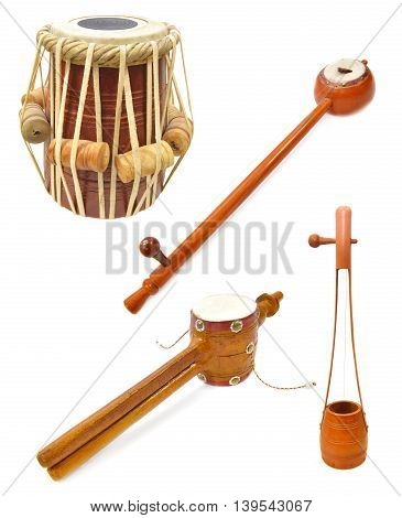 Collection of traditional Indian musical instruments isolated on white