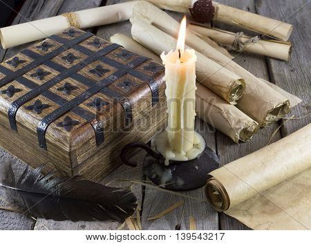 Still life with box, candle and paper scrolls