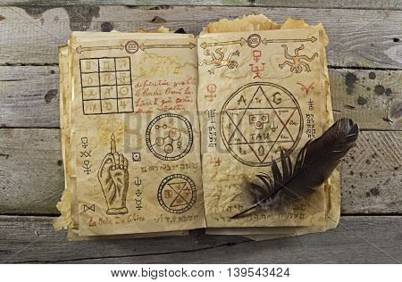 Magic book on wooden planks, Halloween still life