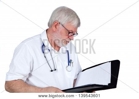 Senior Doctor with a file in his hand reading a report