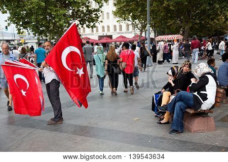 Istanbul Turkey - september 02 2014: Turkish man is selling Turkish flags in the centre of Istanbul