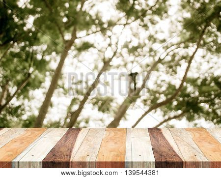 Empty Perspective Table With Blurred Green Tree Forest,template Mock Up For Display Of Your Product.