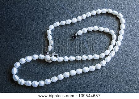 White Pearls On The Black Steel Background
