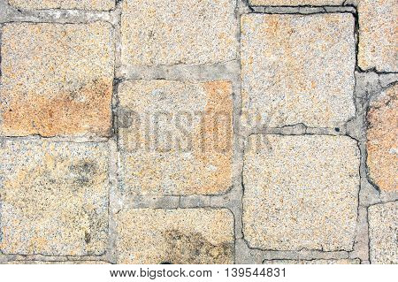close up Rough pavement stone grunge texture background.