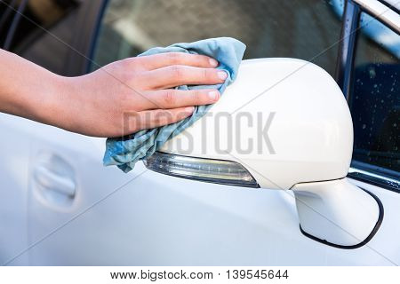 Male Hand With Microfiber Cloth Cleaning Car Mirror