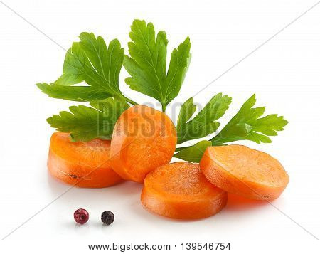 Hanfdul of orange sliced carrot with a fresh green parsley and pepper