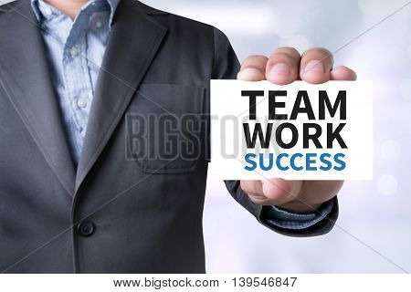 TEAMWORK SUCCESS CONCEPT com man hand top