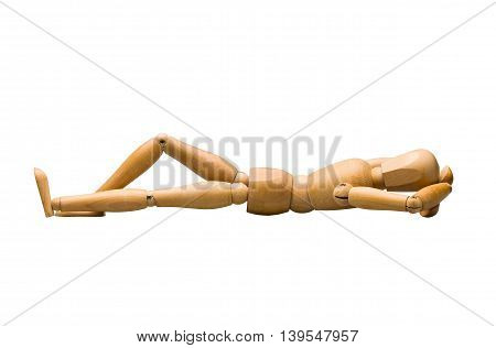 Wooden mannequin lying down, isolated on white.
