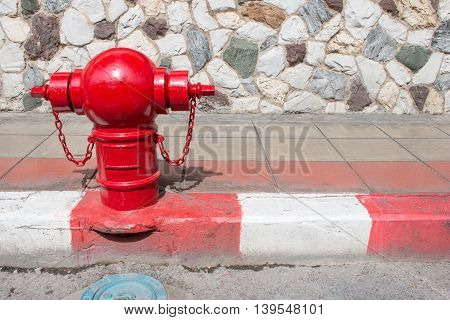Asian Fire Hydrant On Street. Typical Red Fire Hydrant Asian On Street. Red Fire Hydrant Vintage Sty