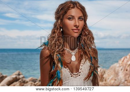beautiful young woman in white dress outdoors portrait