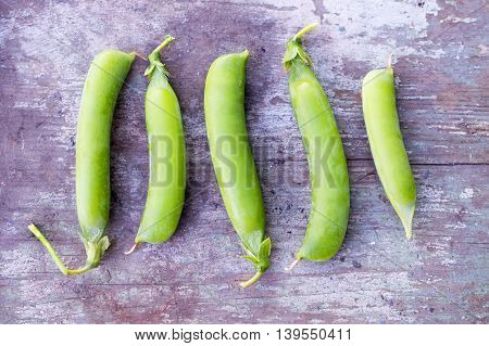 pea pods on a old wooden background