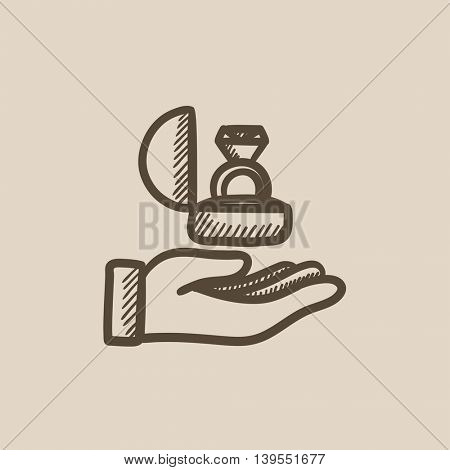 Hand holding gift box with ring vector sketch icon isolated on background. Hand drawn Hand holding gift box with ring icon. Hand holding gift box with ring sketch icon for infographic, website or app.