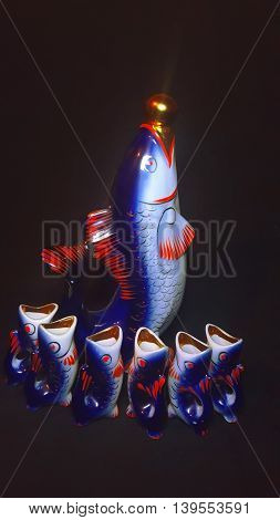 Beautiful bottle and wine glasses in the form of fish
