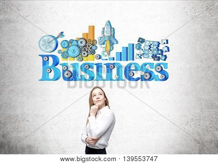 Businesswoman thinkign about future standing in front of concrete wall with colorful sketch on it. Concept of future prospects