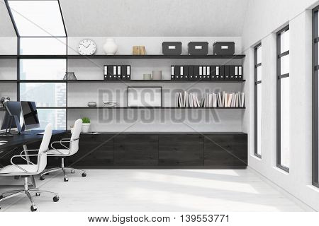 Working place in modern New York office. Book and boxes on shelves computers on desk. Many windows. Picture on wall. 3d rendering. Mock up