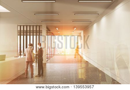 Two businessmen in suits standing near reception in New York office. Man walking in background. Concept of modern business. 3d rendering. Toned image. Double exposure