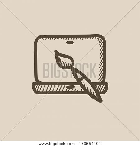 Laptop and brush vector sketch icon isolated on background. Hand drawn Laptop and brush icon. Laptop and brush sketch icon for infographic, website or app.