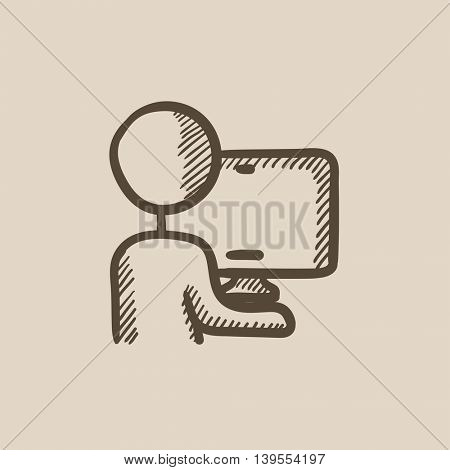 Man working at his computer vector sketch icon isolated on background. Hand drawn Man working at his computer icon. Man working at his computer sketch icon for infographic, website or app.