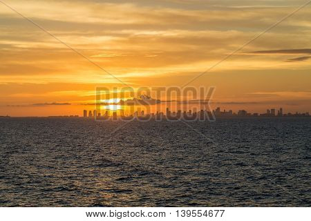 Miami skyline at sunset from the sea